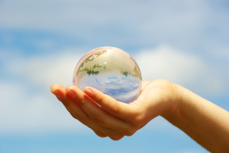 Image of a globe cupped in an extended hand