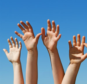 Image of Hands Raised in the Air